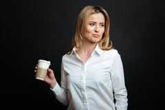 Attractive young woman enjoying cup of coffee in the studio Stock Photography