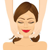 Attractive young woman enjoying facial massage beauty therapy Stock Photos