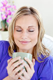 Attractive young woman enjoying her coffee Royalty Free Stock Photo