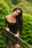 Attractive young woman enjoying her time outside in park Royalty Free Stock Photos