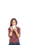 Attractive young woman enjoying the smell of coffee stock photo