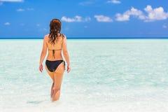 Attractive young woman enjoys Maldivian beach Royalty Free Stock Photography