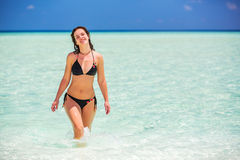 Attractive young woman enjoys Maldivian beach Stock Photography