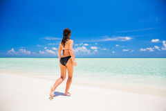 Attractive young woman enjoys Maldivian beach Royalty Free Stock Photo