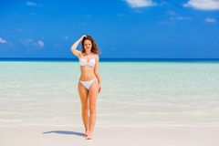 Attractive young woman enjoys Maldivian beach Royalty Free Stock Photos
