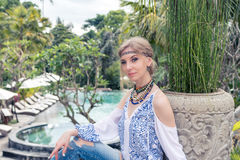 Attractive young woman in ethnic style look posing near the swimming pool, portrait. Tropical island Bali, luxury resort Stock Images