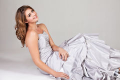 Attractive Young Woman in an Evening Gown Royalty Free Stock Image