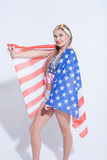 Attractive young woman is evincing her patriotism Royalty Free Stock Photos