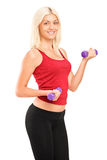 Attractive young woman exercising with weights Royalty Free Stock Photos