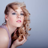 Attractive young woman face with beauty hairs Royalty Free Stock Photo