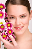 Attractive young woman face with flowers Stock Image