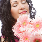 Attractive young woman face with flowers Royalty Free Stock Image