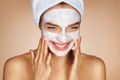 Attractive young woman with face mask Stock Images