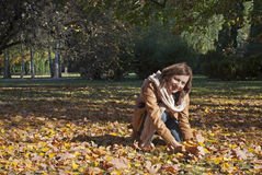 Attractive young woman and fall leaves Stock Photos