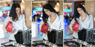 Attractive young woman fashion shot in mall. Beautiful fashionable young lady in white shirt in shopping area Royalty Free Stock Image