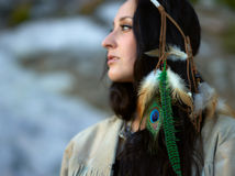Attractive young woman and feather headpiece Royalty Free Stock Photography