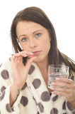 Attractive Young Woman Feeling Hungover and Unwell Taking Medicine Stock Photo