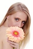 Attractive young woman with a flower Stock Photography