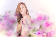 Attractive Young Woman and Flowers Stock Photos