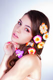 Attractive young woman with flowers in hair Royalty Free Stock Photo