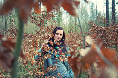 Attractive young woman in the forest Royalty Free Stock Photo