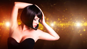 Attractive young woman in front of a club background. Young woman in front of a club background Stock Photos