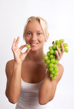 Attractive young woman with fruit Royalty Free Stock Photos