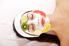 Attractive young woman with fruit mask on a face Stock Photo