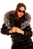 Attractive young woman in fur coat stock photos