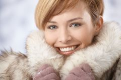 Attractive young woman in fur coat Stock Photography