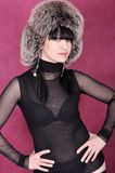 Attractive young woman in fur hat Royalty Free Stock Image