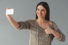 Attractive young woman with gadget Stock Images