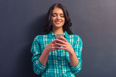 Attractive young woman with gadget Royalty Free Stock Photography