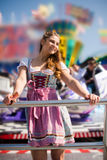 Attractive young woman at German funfair Oktoberfest with traditional dirndl dress Stock Image
