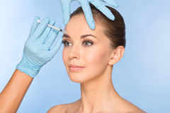 Attractive young woman gets cosmetic injection of botox Royalty Free Stock Photo