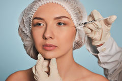 Attractive young woman gets cosmetic injection Stock Image