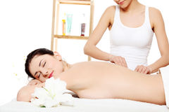 Attractive young woman getting spa treatment Stock Photos