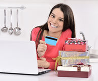 Attractive young woman with gift boxes Stock Image
