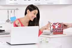 Attractive young woman with gift boxes Royalty Free Stock Photos