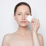 Attractive young woman. Attractive young girl removes makeup from the face Stock Images