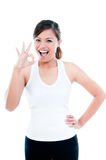 Attractive Young Woman Giving OK gesture Royalty Free Stock Photography