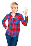 Attractive Young Woman Giving the OK Hand Sign stock image