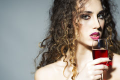 Attractive young woman with glass of red wine Royalty Free Stock Image