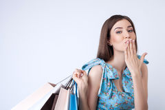 Attractive young woman is going shopping with stock images