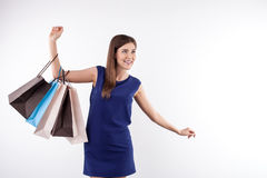 Attractive young woman is going shopping with joy Royalty Free Stock Photography