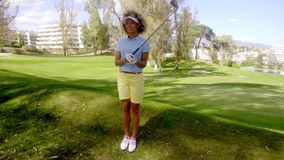 Attractive young woman golfer standing watching stock video