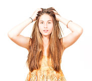 Attractive young woman grabs in her hair Stock Photo