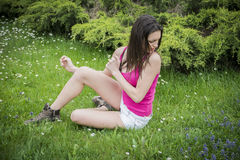 Attractive young woman on grass scared by insects Stock Photography
