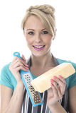 Attractive Young Woman Grating Cheese Royalty Free Stock Photo