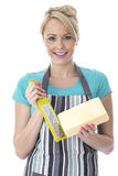 Attractive Young Woman Grating Cheese Stock Photos